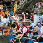14628808-Bedford-England-July-22-People-race-self-built-rafts-down-the-River-Great-Ouse-at-the-bi-annual-Bedf-Stock-Photo